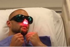 Covid patient using nasal red light therapy