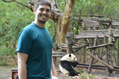 Andrew LaTour visiting a Panda in China