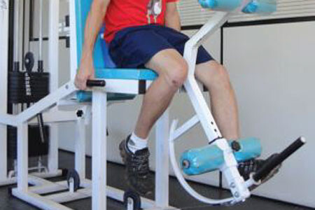 Twin muscle photobiomodulation leg extension exercise